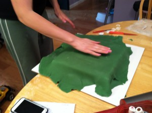 Laying the fondant over the chocolate cake