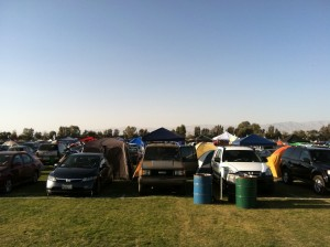 Front view of a line of cars parked in Coachella car camping.