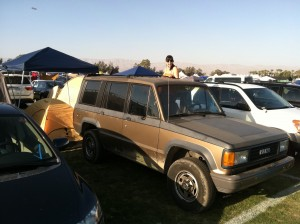 Side view of the fronts of cars parked in Coachella car camping.
