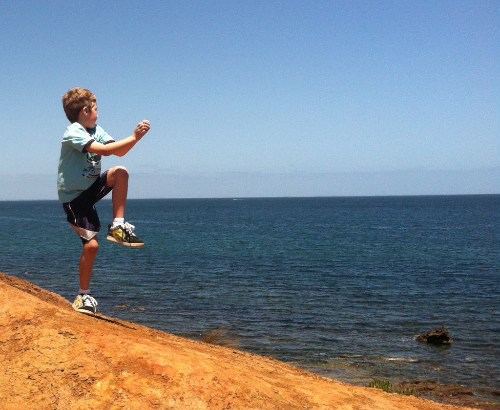 Brandon throwing rocks at Schnapper Point in Mornington