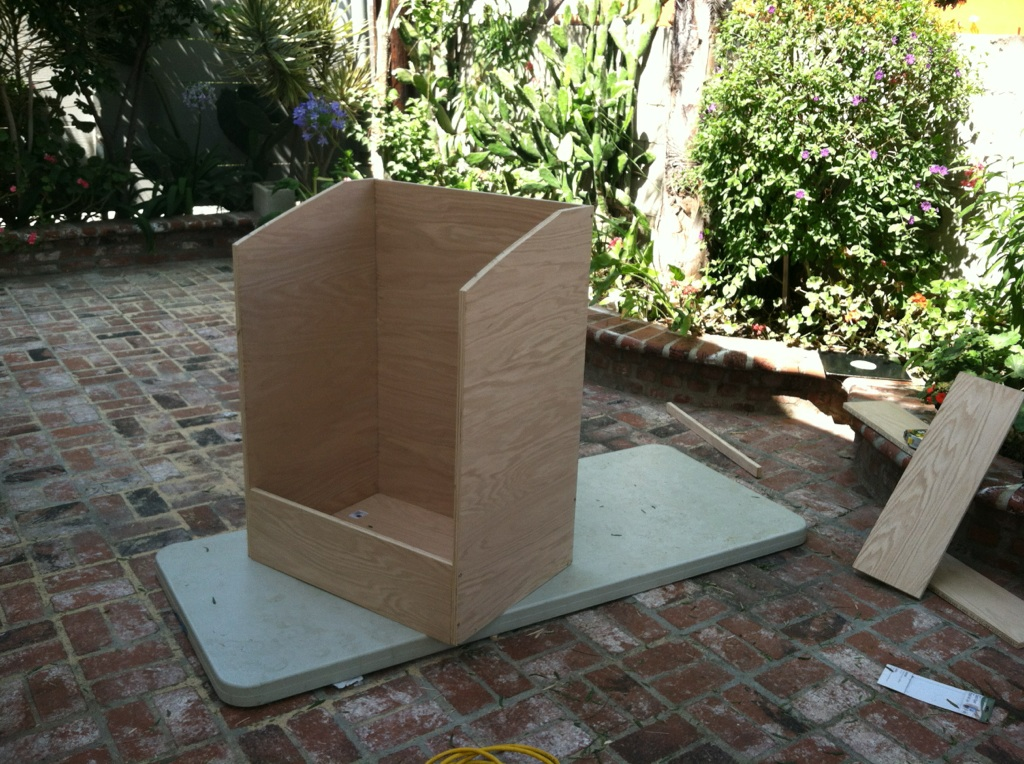 Beginning to assemble the wooden record storage bin