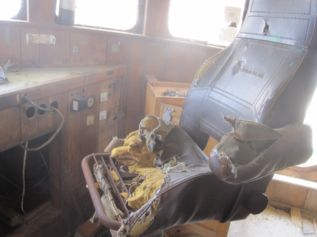 Captains seat in the bridge on an abandoned fishing boat on Wachapreague island
