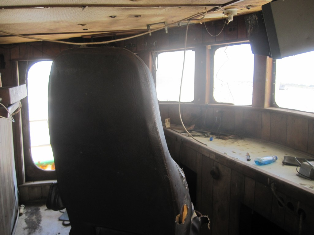 Captains seat in the bridge on an abandoned fishing boat