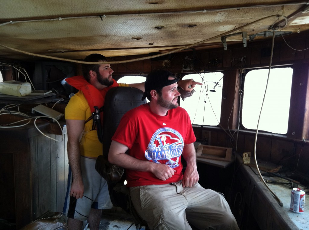 Trying out the captains seat in the bridge on an abandoned fishing boat on Wachapreague island