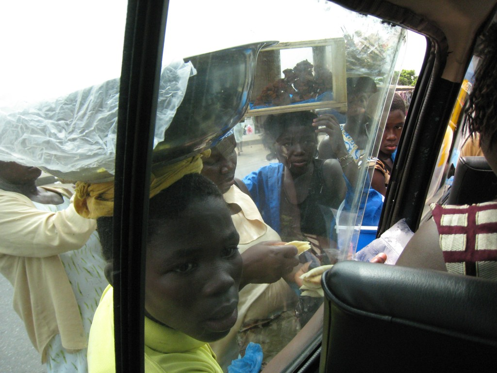 Ghanians selling things through tro-tro windows