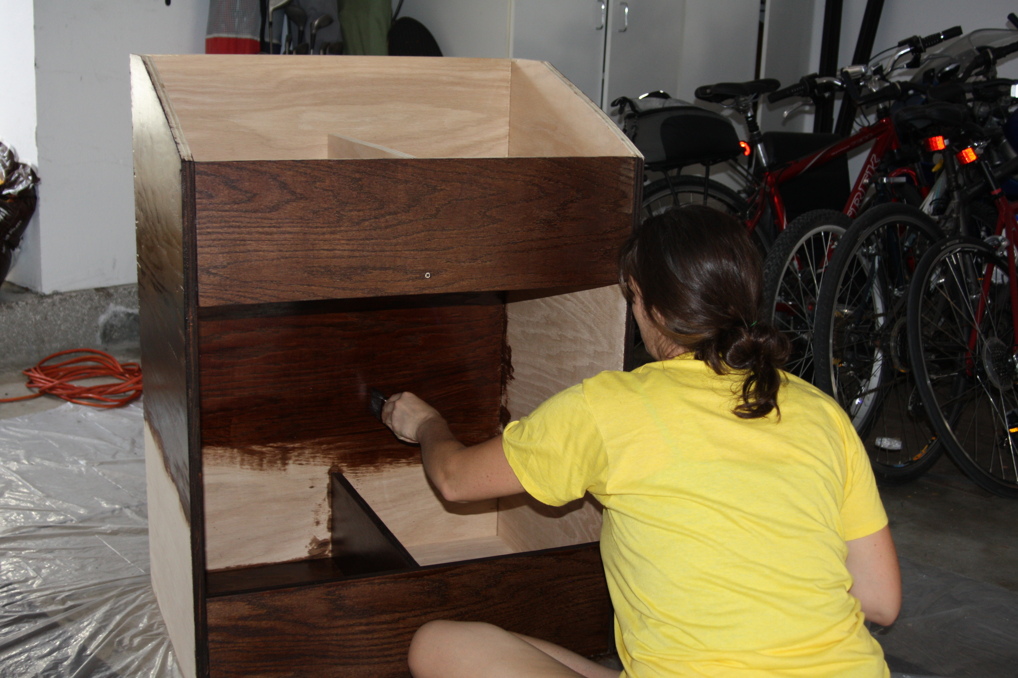 lauren applying a polyurethane finish to the record storage bin front shot finished vinyl record