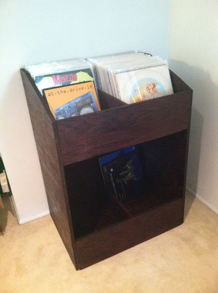 Completed wooden record shelf with vinyl records inside