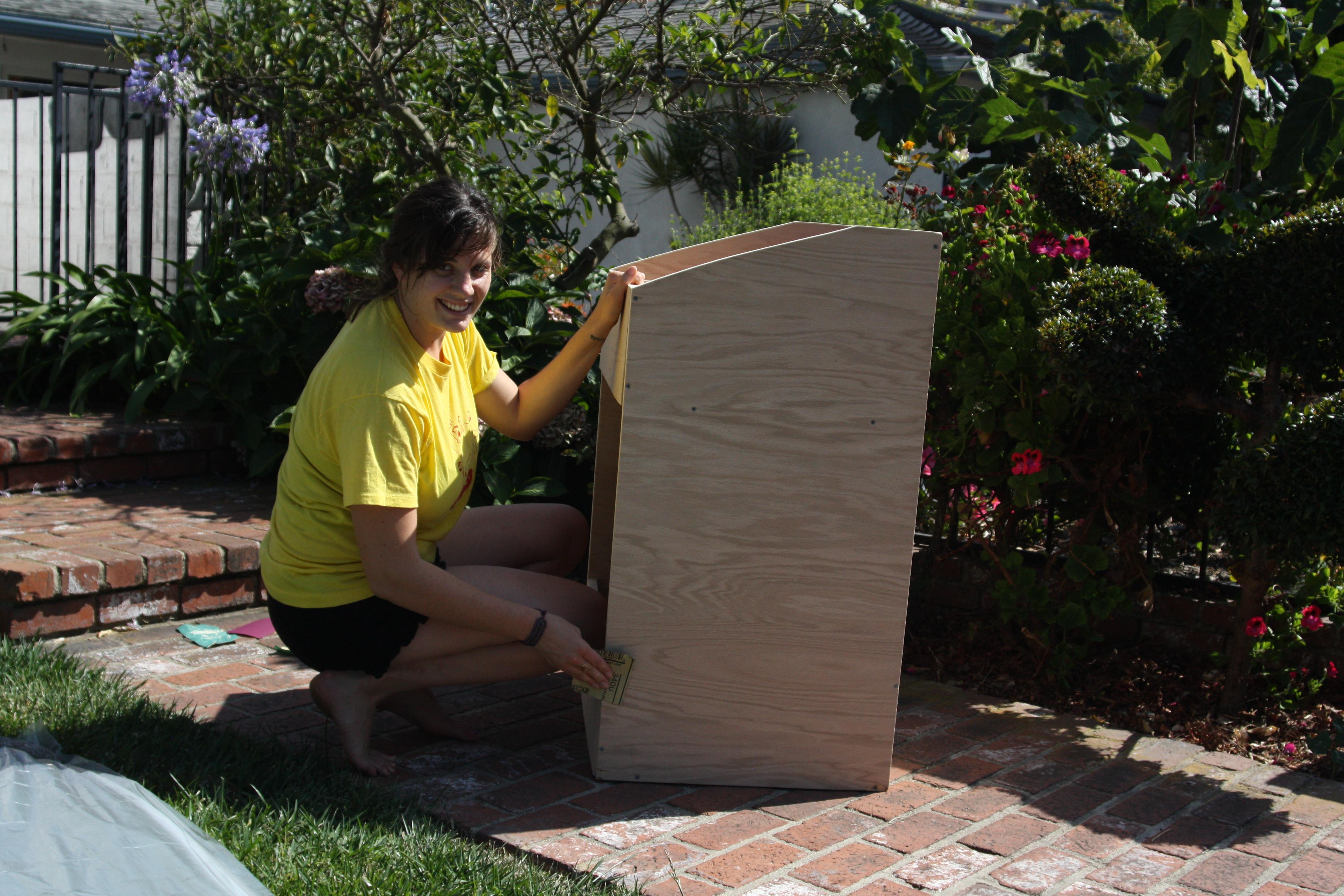 Lauren sanding the wooden record storage bin