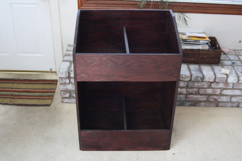 A front shot of the finished wooden record shelf
