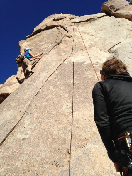 Ethan belaying Lesley on Friend Eater in Joshua Tree.
