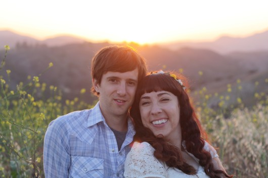 Engagement photos during sunset in a meadow