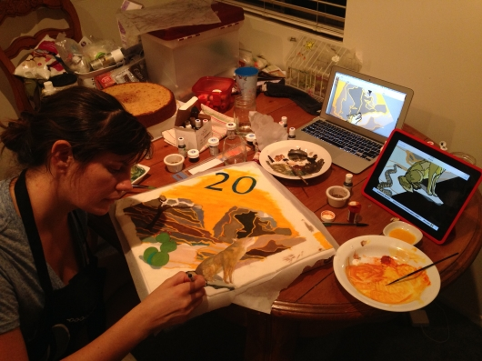 Lauren designing logo on cake