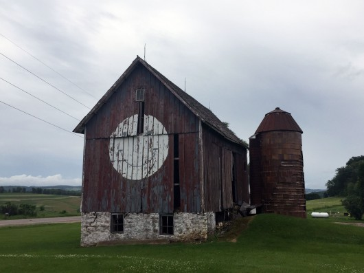 Barn in Wisconsin with big smiley face painted on the side.