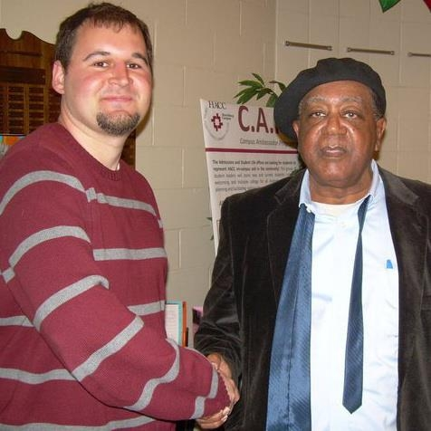 Kyle and Bobby Seale of the Black Panther Party